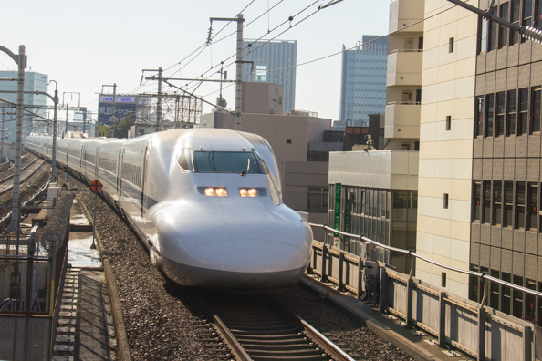 Shinkansen (bullet train) arriving at Kyoto station in Japan
