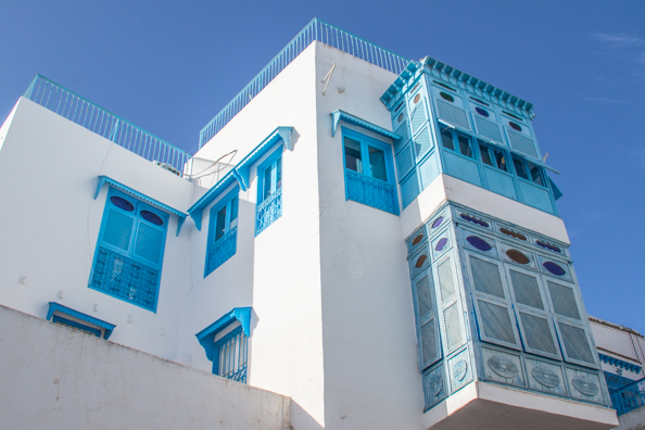 Traditional shutters or moucharabiehs, on a building in Sidi Bou Said Tunisia