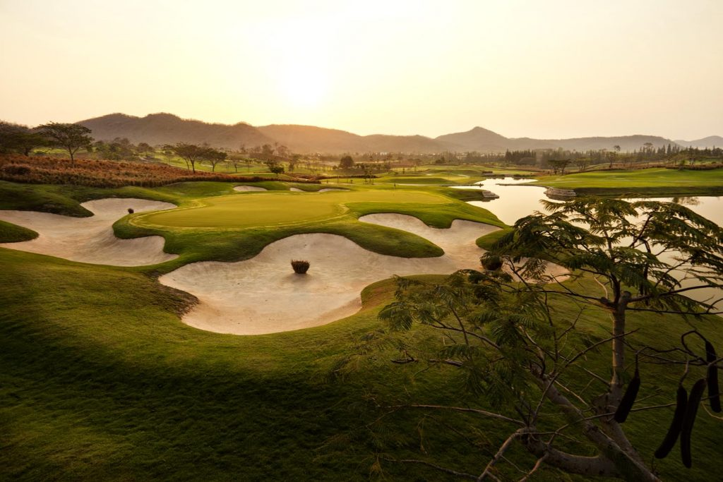 picture of thai golf course with amazing jungle clad hills in the background