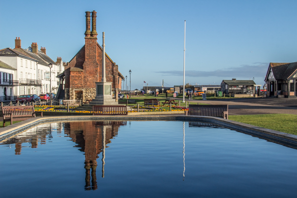Moot Hall and War Memorial reflected in the Model Boating Pond in Aldeburgh, Suffolk